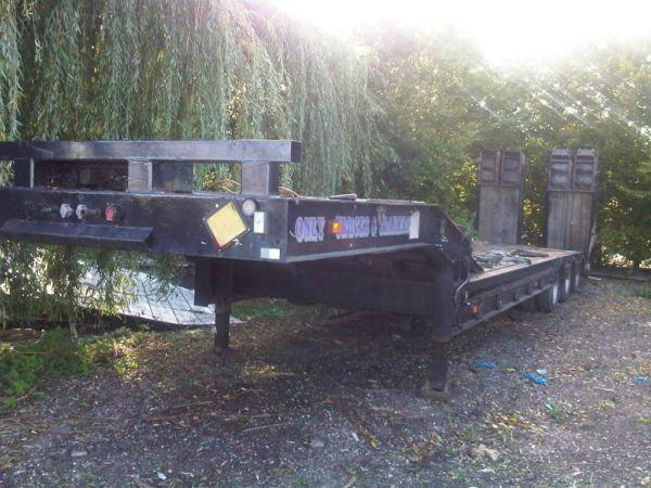 King low loader plant trailer with hydraulic ramps and winch. Year: 1994