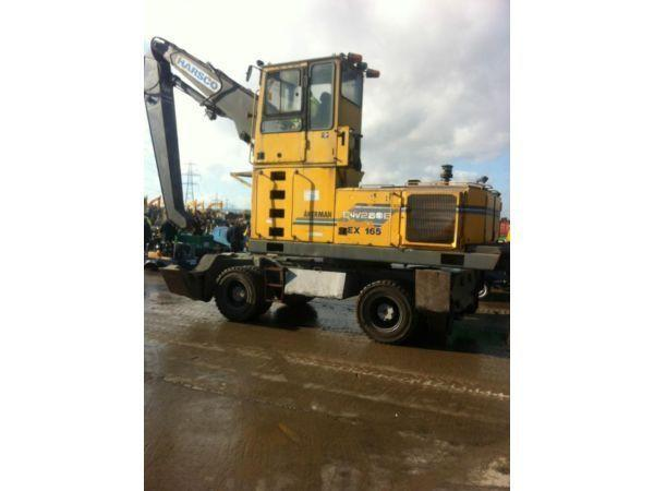HIGH RISE CAB AKERMAN EW230 SCRAP HANDLER WITH STABILISERS AND PIPED FOR GRAB